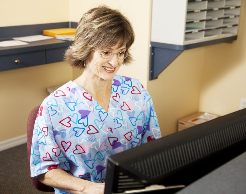 Medical Assistant working at her desk