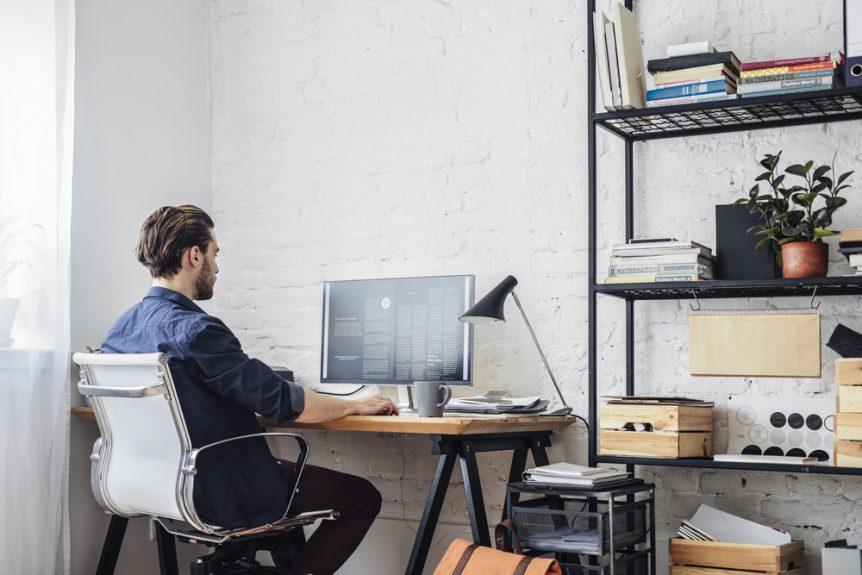 Young man working at home at his computer