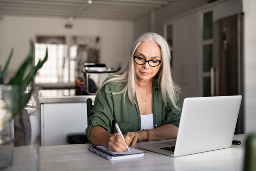Woman working in front of a laptop at a desk