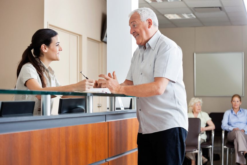 Medical Assistant Checking In an Elderly Patient